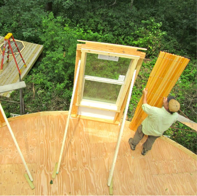 man setting up a yurt and yurt windows