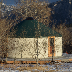 white yurt with a green door