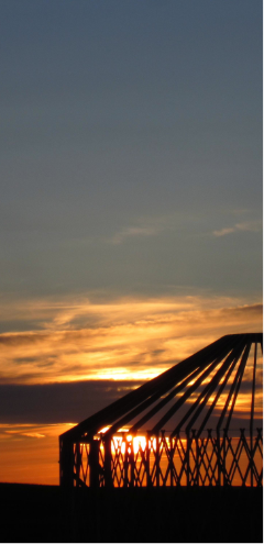 big sky yurt frame against a sunset