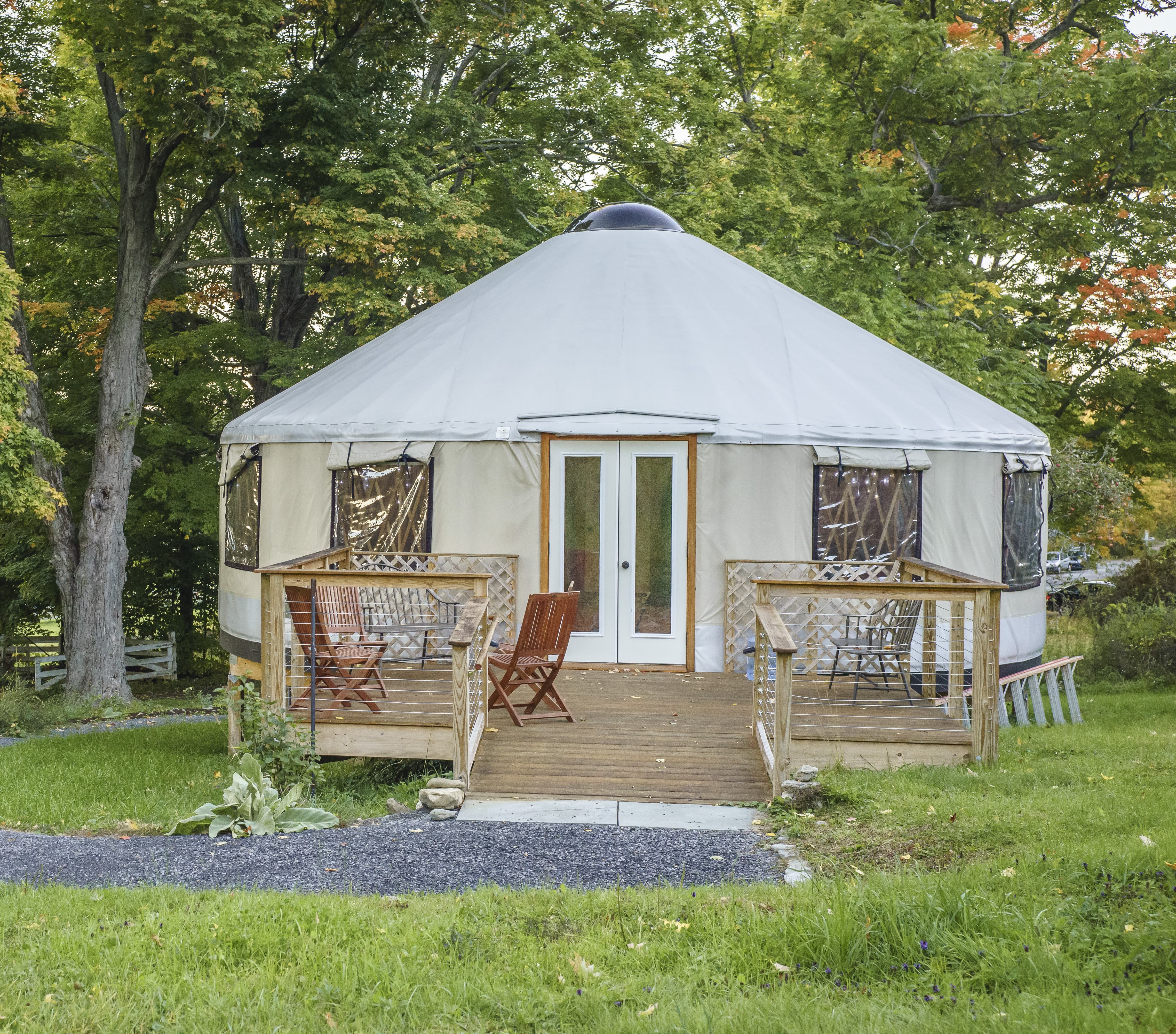 shelter designs yurt with a porch and chairs