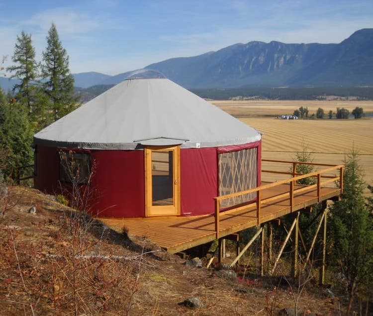 red shelter designs yurt on a platform in flathead valley