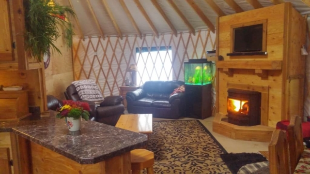 yurt living room with a fireplace