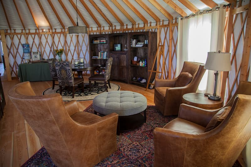 living room and dining room inside a yurt house